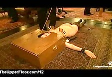 boxed head babe caned and flogged in the upper floor