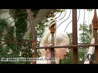 Naughty blonde punishing a naked redhead babe outdoors