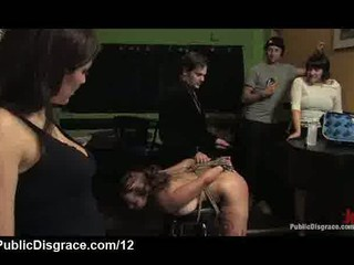 Ass hooked busty babe spanked in bar full of people