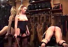 Domme in Stockings Spanks Straps and Canes