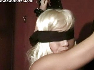 Blond blind folded slave with beautiful body gets spanked on