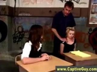 Schoolgirl dominas spank teacher