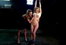 blonde young femdom flogging blonde sub