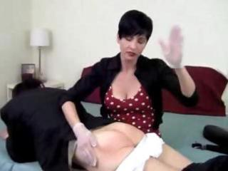 He was a naughty boy and now he gets his spanking punishment from his brunette wife