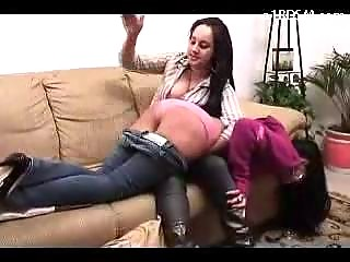 Long Haired Girl Screaming While Getting Her Ass Spanked Red By Other Girl On The Couch