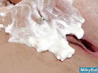 Mia Hilton spreads whip cream over naked body