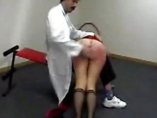Girl laying on a doctor lap getting her ass spanked to red