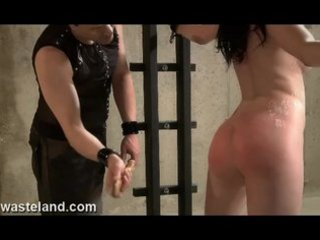 Redhead Submissive Chained To Rack, Whipped, Waxed and Made To Cum Hard