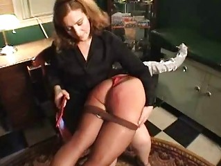 Hot girl suffers through a painful spanking