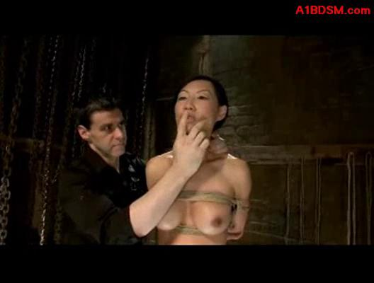 Asian girl trained as slave bondaged balancing while spanked