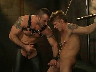A slave boy gets a cock tortue as a punishment