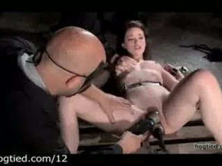 Bound babe flogged and toyed by masters in dungeon
