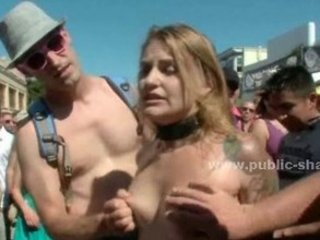 Sexy redhead mistress spanks naked slave in public before she get